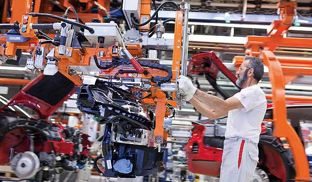 An employee works on the assembly line at the Audi automobile plant in Ingolstadt.