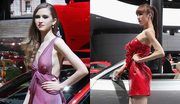 Models on the Ferrari (left) and Audi stands at the 2012 Beijing Auto Show.