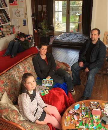 Bryony and Daniel Bedggood, with children Eva and Tom, live and sleep in the central part of their badly damaged TC3-category home.