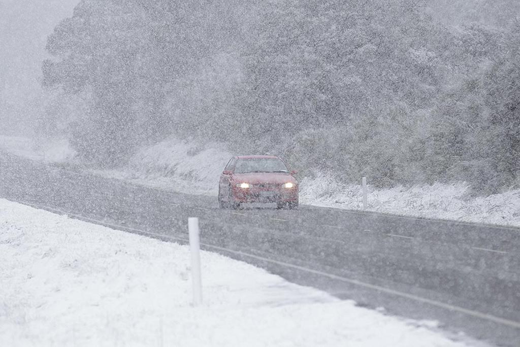 BLIZZARD: Snow makes road travel difficult on SH2 near Mt Bruce, in the Wairarapa.