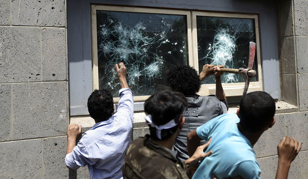 FURY: Protesters break windows at the United States embassy in Sanaa.