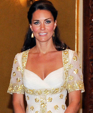 Kate, Britain's Duchess of Cambridge, poses before an official dinner hosted by Malaysia's king in Kuala Lumpur.