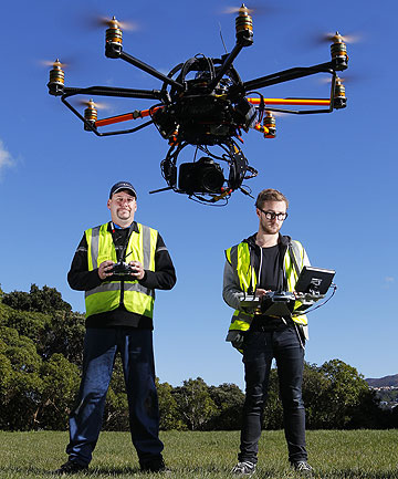 BIRDSEYE VIEW: Ryan Cadwallader (pilot), left, and Ben Forman (camera operator) with the aerial photography flying machine Sycamore.