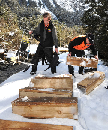 Conservation Department takahe ranger Martin Genet and Te Anau Mitre 10 manager Neil Hodges prepare to move stoat traps