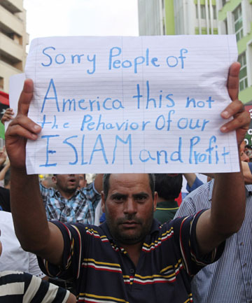 SUPPORTERS RALLY: A demonstrator holds a message during a rally last week to condemn the killers of the US Ambassador