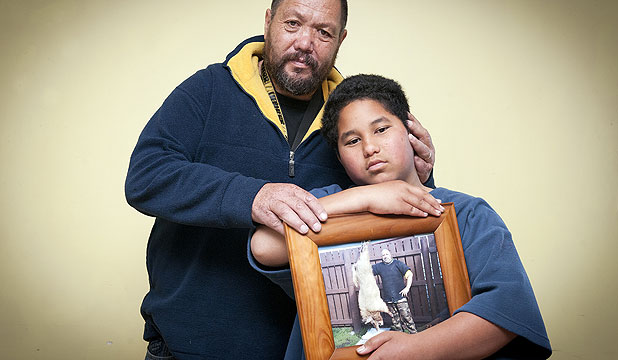 'HE WOULD BE PROUD': Mikaere Kiel, with his uncle George Cairns, holds a photo of his koro, Inia Kiel.