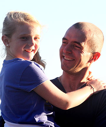 Taranaki Cathedral Dean Jamie Allen enjoys the sunshine at Back Beach this year with his daughter, Carrie.