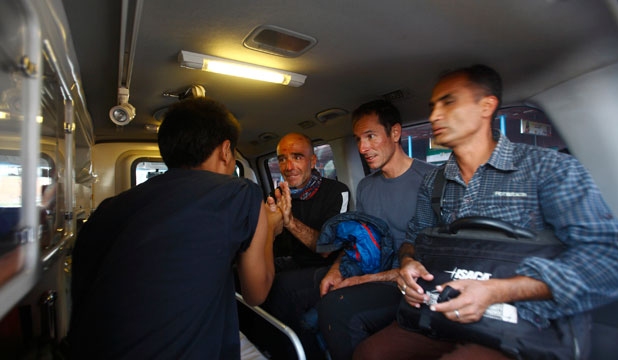 French tourists sit inside an ambulance after being rescued from an avalanche at Mount Manaslu in Kathmandu.