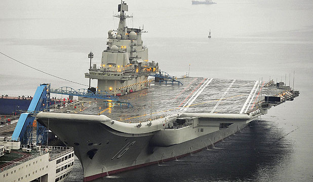 MORE TO COME: China's first aircraft carrier is seen docked at Dalian Port, in Dalian, Liaoning province.