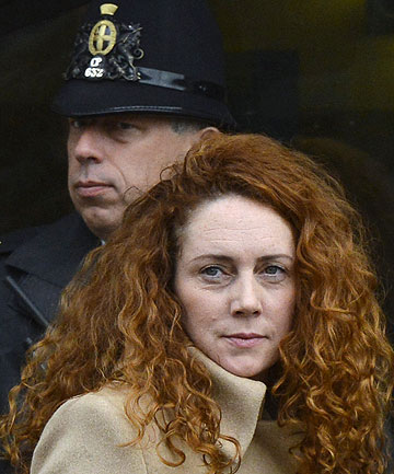 CHARGED IN PHONE HACKING CONSPIRACY: Former News International chief executive Rebekah Brooks leaves the Old Bailey court in London.