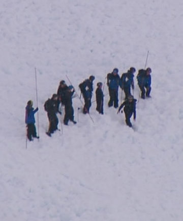 AVALANCHE ALERT: Searchers work their way across an avalanche on a slope just outside the Remarkables Ski Area.