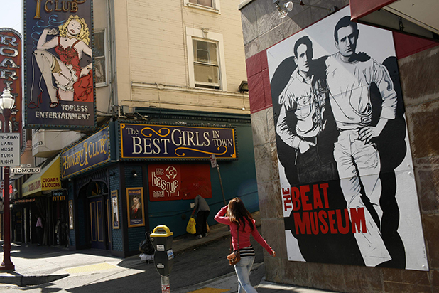 The figures of author Jack Kerouac (left) and Neal Cassady are painted on the wall of the Beat Museum in the North Beach neighborhood in San Francisco. Kerouac and the Beat poets called the cafes and bars of the neighborhood home and many of their favorite haunts still exist