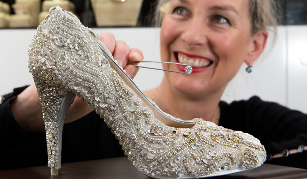 Jewellery designer Sarah Hutchings spent hours painstakingly attaching white diamonds to this Kathryn Wilson shoe, which will be auctioned for charity.