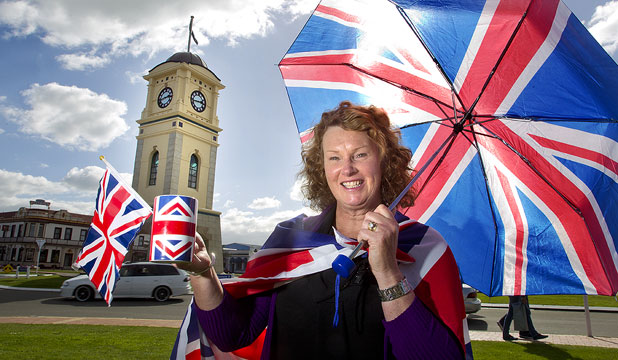 SHOWING THE FLAG: In a photo taken two weeks ago, Feilding Promotions manager Helen Worboys gets in the mood for a right royal visit by Prince Charles and his wife, the Duchess of Cornwall.