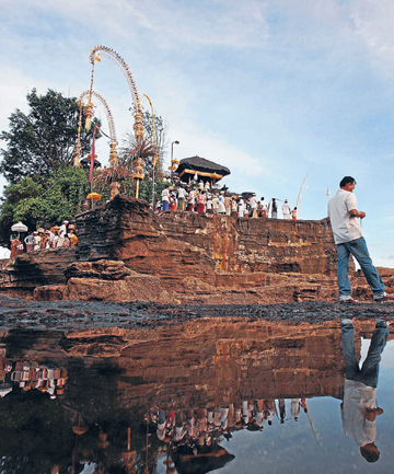 DODGE THE CROWDS: Traditional ceremonies in more remote corners of Bali such as at Tanah Lot temple near Tabanan can still provide a Balinese experience stripped of the crowds and commercialism.