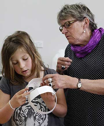 Christine Mackenzie and 8-year-old Rosa Cachemaille, both of Nelson, during the mask-making workshop at the NMIT Arts and Media building yesterday.