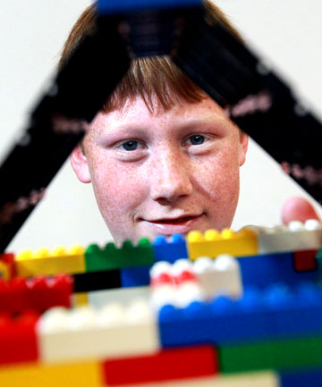 Jacob Fletcher, 13, shows off the Lego house he built during Habitat Awareness Week
