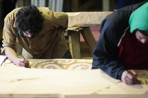 HANDS ON WOOD: James Cannon, left, and Ronz Grey at work.