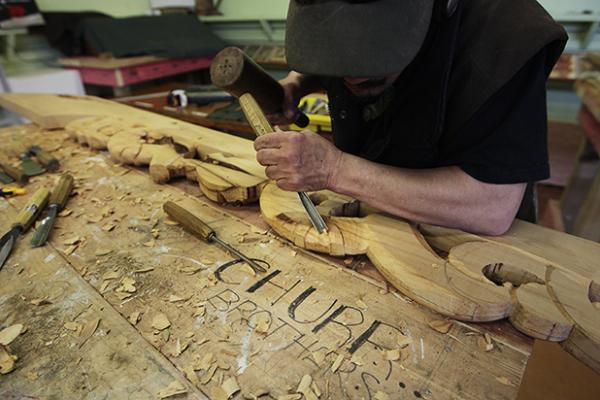 CHIPPING AWAY: Bob Te Huia carves culture into timber.