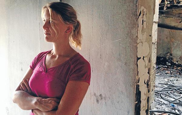 UNSETTLING TIMES: Robyn Davey stands in the ruin of a classroom at the school where she works in Tunis. Of the attack on the school she says: ''People are very, very shocked and dismayed that this would happen. If there is a silver lining, it's that general Tunisians have had to stand up and say this is not what they want their country to be.''