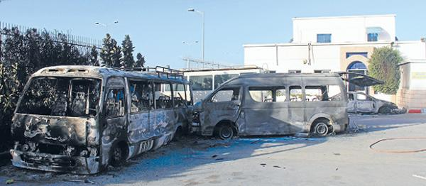 BURNT OUT: Buses were also targeted in the riots in Tunis, a reaction to the film The Innocence of Muslims.