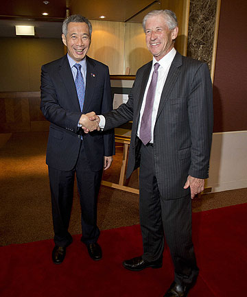 TALKING ASIA: Asia New Zealand Foundation chairman Philip Burdon greets the Singaporean Prime Minister Lee Hsien Loong at the Stamford Plaza Hotel in central Auckland.