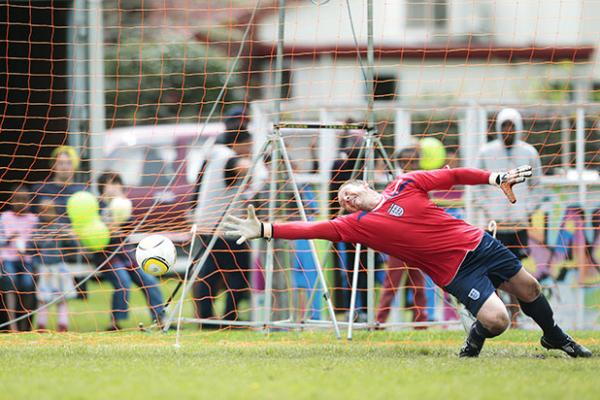 OUT OF REACH: England goalie Neil Moucher stretches out in an attempt to stop a goal in the penalty shootout.