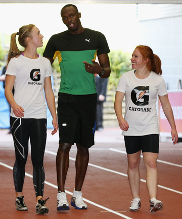 READY TO RACE: Morrinsville sprinter Kristie Baillie (left) gets some tips from Olympic gold medallist Usain Bolt during his recent visit to New