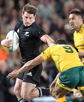 Cory Jane fends off a Wallaby during the All Blacks win over Australia in the Rugby Championship at Eden Park.