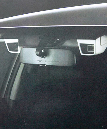 The pair of small ceiling-mounted cameras that are the eyes of Subaru's EyeSight driver assist system.
