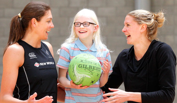 Olivia Wickens, 10, meets Silver Ferns Irene van Dyk, left,  and Casey Williams