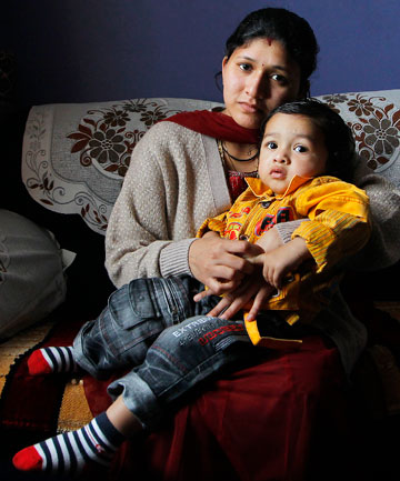 UNHYGIENIC OPTION: Jayshriben Patel, 26, and her son,  Aryan, 18 months. She was told to stop breastfeeding at the Indian Community Hall in Wellington.
