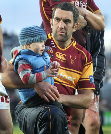 Hoani MacDonald with his son, Iwi, at Rugby Park last month.