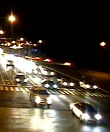 GETTING OUT OF HARM'S WAY: Traffic in Honolulu heads away from the coast after a tsunami warning was issued following a 7.7 earthquake off Canada's Pacific coast.