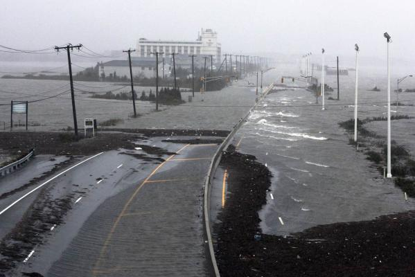 US Route 30, the White Horse Pike, one of three major approaches to Atlantic City, New Jersey, is covered with water from Absecon Bay in this view looking west, during the approach of Hurricane Sandy.