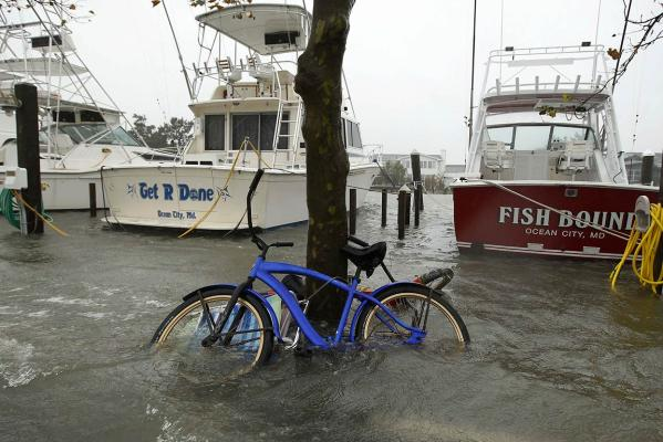 A marina floods onto the road as Hurricane Sandy hits Ocean City, Maryland.