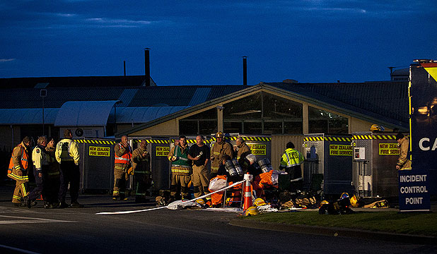 HARMFUL FUMES: Emergency services workers outside the Tasman Tannery factory in Whanganui, where two workers were found unconscious after inhaling toxic gas fumes