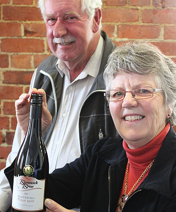 TOP WINE: Crawford and Catherine Brown of Bannock Brae Vineyard with the pinot noir crowned champion wine at the New Zealand  International Wine Show.