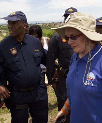 Police officers block Helen Zille, leader of the opposition Democratic Alliance party, from walking towards South Africa's President Jacob Zuma's house in Nkandla.