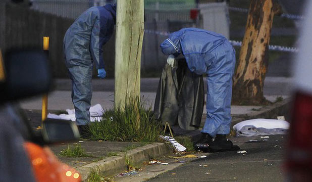 Police forensic officers examine wedding suits after a triple shooting in Sydney.