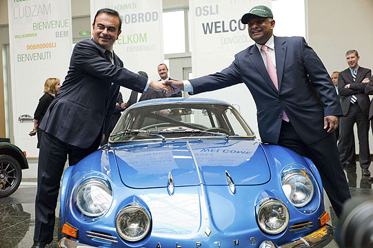 Carlos Ghosn (left), chairman and CEO of the Renault-Nissan Alliance, and AirAsia Group CEO and Caterham Group Chairman Tony Fernandes shake hands over an Alpine sports car after a press conference announced their joint venture to develop sports cars.