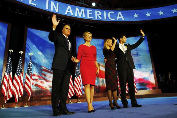 U.S. Republican presidential nominee Mitt Romney waves Mitt Romney with his wife Ann alongside Republican vice presidential nominee Paul Ryan, right, and his wife Janna after Romney delivered his concession speech.