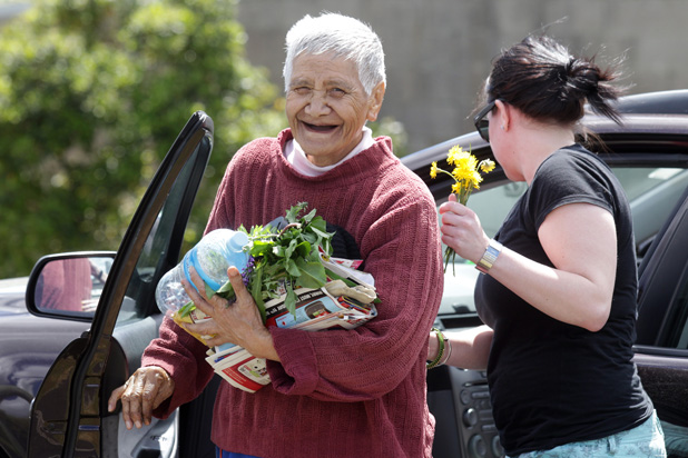 SAFE AND SOUND: Diana Mitchell, 75, is all smiles as she arrives home with neighbour, Jaime Anderson.