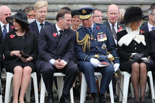 Prince Charles and his wife, Camilla, Duchess of Cornwall, with NZ Prime Minister John Key and his wife Bronagh (left) brave the breeze during the Armistice Day commemorations outside the Auckland War Memorial Museum.