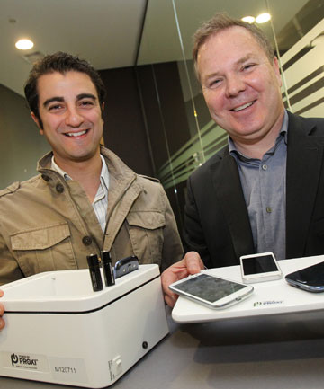 Fady Mishriki,  PowerbyProxi chief executive, left, and executive chairman Greg Cross with the one-spot charging equipment the wireless power technology company has developed.