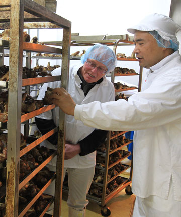 Kisco Foods International Ltd produces veal stock and a white sauce for the Japanese market. Graham Kitson, left, and general manager, Tatsumi Hasegawa view the product.
