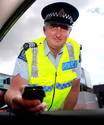 Sergeant George White prepares to breath test a driver