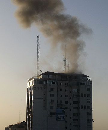 MEDIA TARGETED: Smoke rises after an Israeli air strike on an office of Hamas television channel Al-Aqsa in Gaza City.