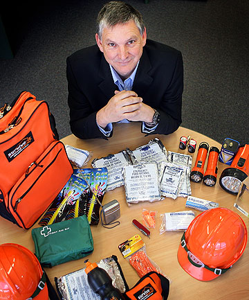 TOP KIT:  Survive-It managing director Rod Hall with a selection of emergency products. The company enforces high standards of quality and reliability.
