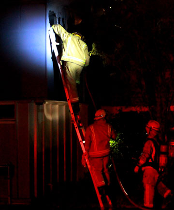 Firefighters at the scene of the blaze at New Plymouth Girls's High School on Sunday night.